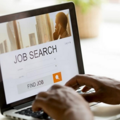 a person uses a laptop to do a job search
