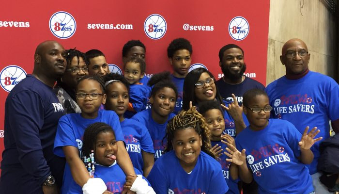 a group of children and adults at an 87ers event
