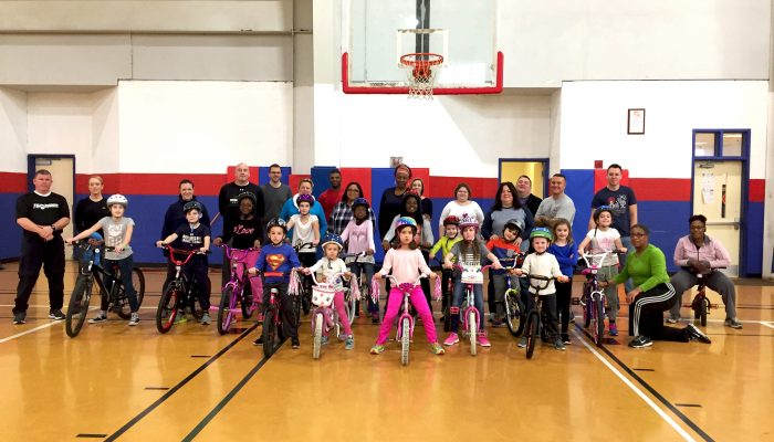 children pose on their bikes for the police athletic league of wilmington bike program